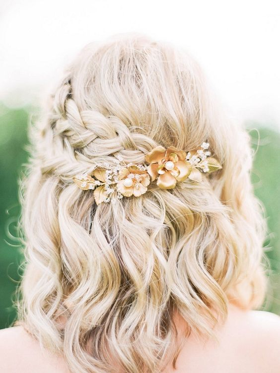 Hairstyle for medium hair with a braid and a hairpin with flowers, a romantic look