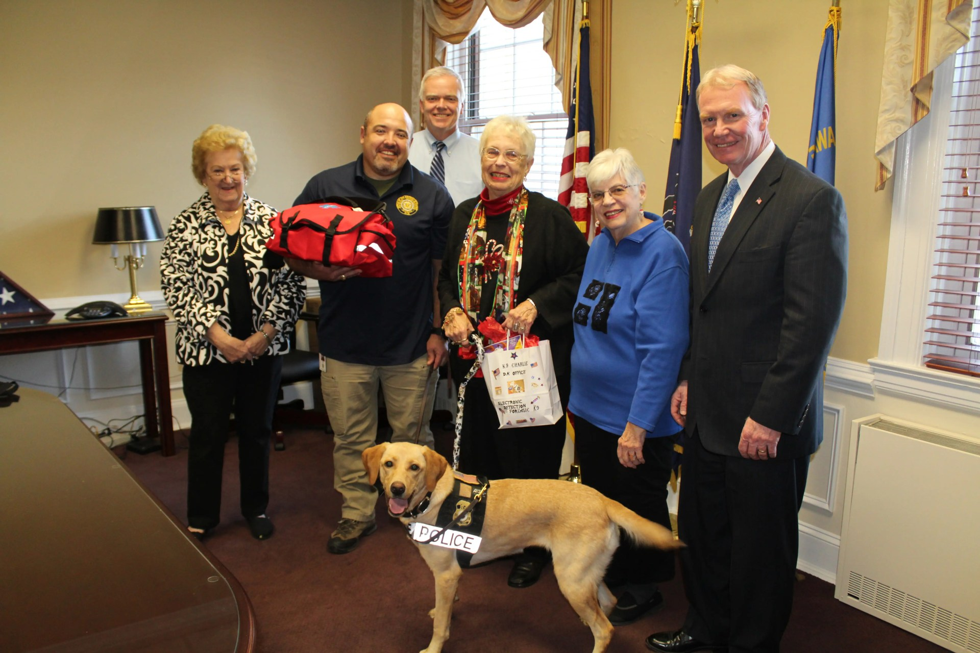 Pictured from left, Delaware County Kennel Club member Patricia Hamilton, Nat Evans, K-9 handler and ICAC forensic analyst, Chief Joseph Ryan of the Delaware County Criminal Investigation Division, Delaware County Kennel Club member Marge Remolde, ICAC K-9 Charlie, Delaware County Kennel Club member Jane Kramer and District Attorney Jack Whelan.