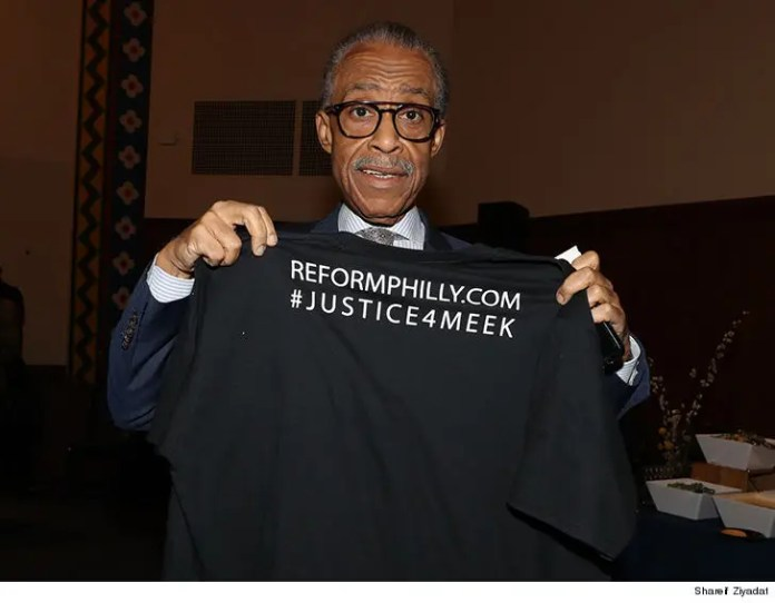 Al Sharpton holding a #JUSTIC4MEEK shirt up at his REFORM rally Tuesday at the University of Pennsylvania. (SHARIF ZIYADAI)