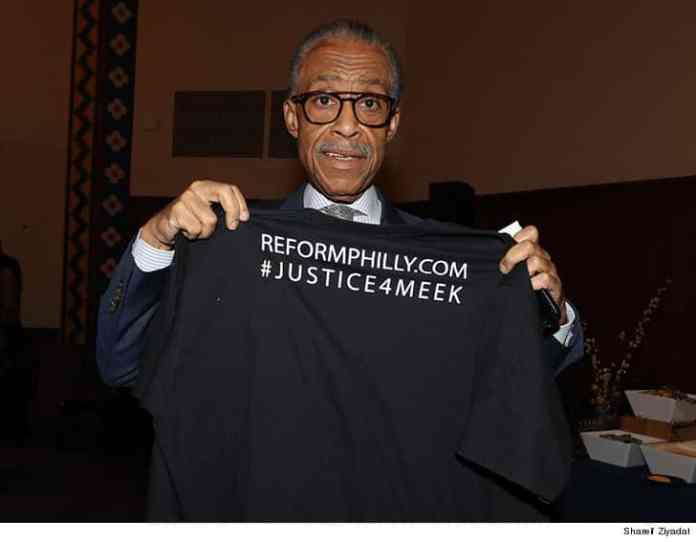 Al Sharpton holding a #JUSTIC4MEEK shirt up at his REFORM rally Tuesday at the University of Pennsylvania. (SHARIF ZIYADAI)