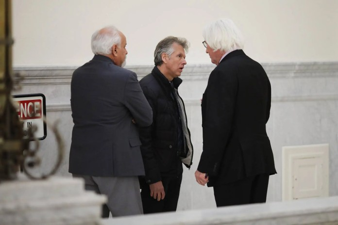 Defense attorney Tom Mesereau (right) and famed private investigator Scott Ross (left) telling Robert Russell (middle) that Judge Steven T. O'Neill barred him from testifying to the dark background of the Constand family, forcing him to limit his testimony to the fact that Andrea Constand told him she was interested in becoming a sports broadcaster. (Reuters/Pool Photo)