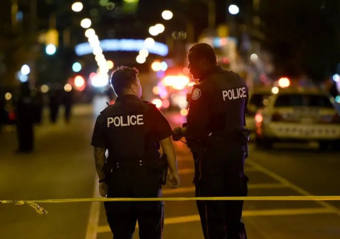 Police work the scene of a shooting in Toronto on Sunday, July 22, 2018. (Nathan Denette/The Canadian Press via AP)