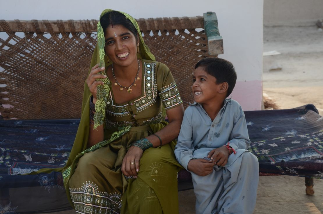 YMCA Pakistan, young-female-beneficiary-with-son