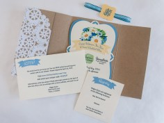 The blue and yellow wedding colors are carried through the entire suite, accented by a beautiful, textured cream paper.