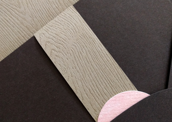 Closeup of woodgrain texture on invitation
