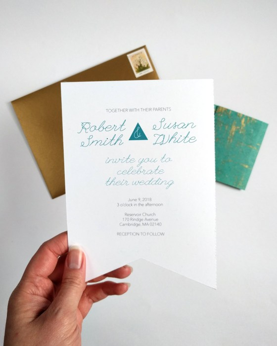Wedding invitation in hand