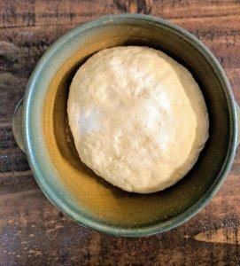 preparing bread dough to rise