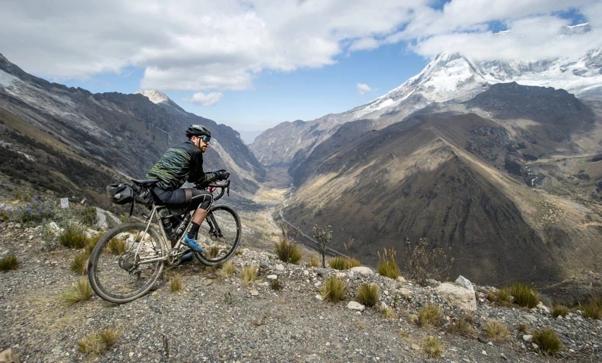 Cycling in Peru - Adventure Bike Rider looks out on the Andes Mountain Range
