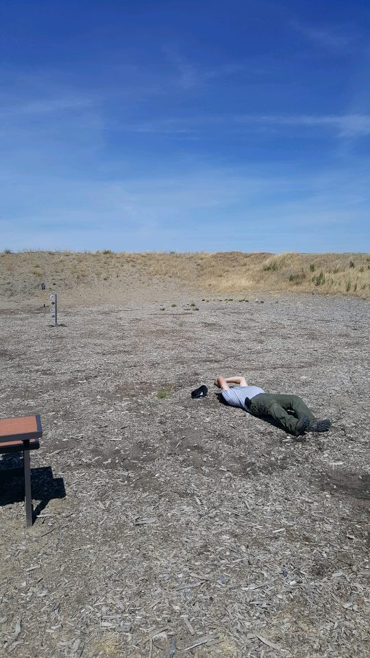 Richard attempts an upside down prone shot with his Ruger 9mm at the YHC Fun Shoot.  Rick Made the shot!