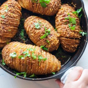 Baked Parmesan Hasselback Potatoes with herbs and garlic
