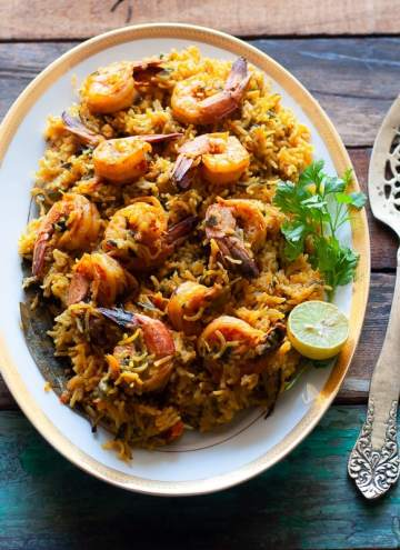 Easy Prawn Pulav Recipe made with Indian whole spices, Coconut Milk and coriander and mint leaves with both Instant Pot and Stove Top methods