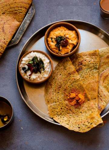 Pesarattu - Green Moong Dal dosa made with lentils, green chillies and Garlic.This is a great Vegan, Gluten Free & low carb indian breakfast dish.