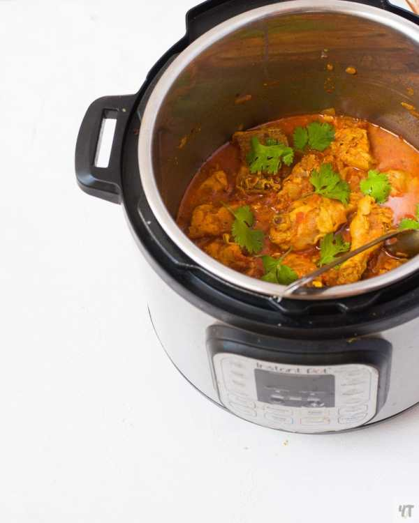 Instant Pot Indian Chicken Curry - Quick & Easy Desi Chicken Curry recipe made with bone in chicken, yogurt and spices under 30 minutes. #chickencurry #indian #instantpot #curry #easy #quick #indianfood #indianrecipe #recipe #instantpotindianrecipe