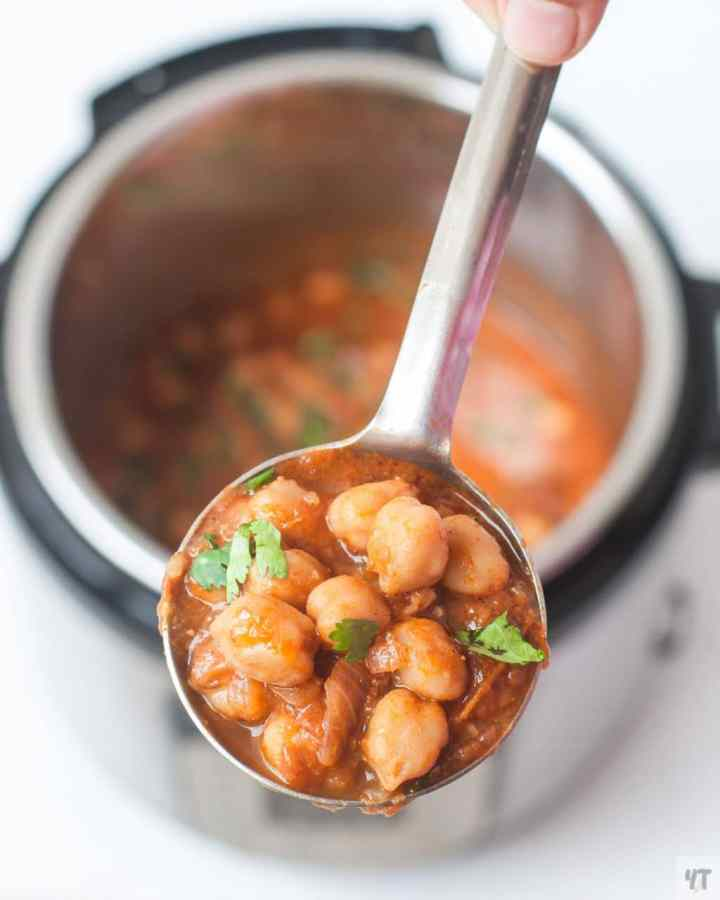 Instant Pot Chana Masala recipe - Indian Spiced Curry made with Dried Chickpeas or Garbanzo Beans. Vegan, Meal prep freindly Punjabi Chole Masala Recipe. #chole #chickpeas #garbanzobeans #instantpot #pressurecooked #indian #indianrecipe #recipe #vegan #glutenfree