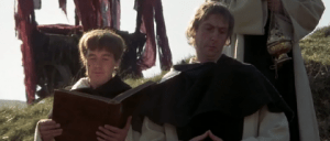 Michael Palin as the Cleric; Eric Idle as Brother Maynard