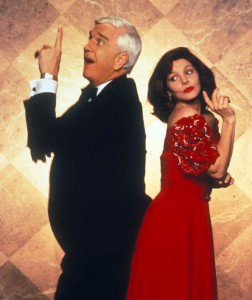 Leslie Nielsen & Priscilla Presley as Frank Drebin & Jane Spencer.