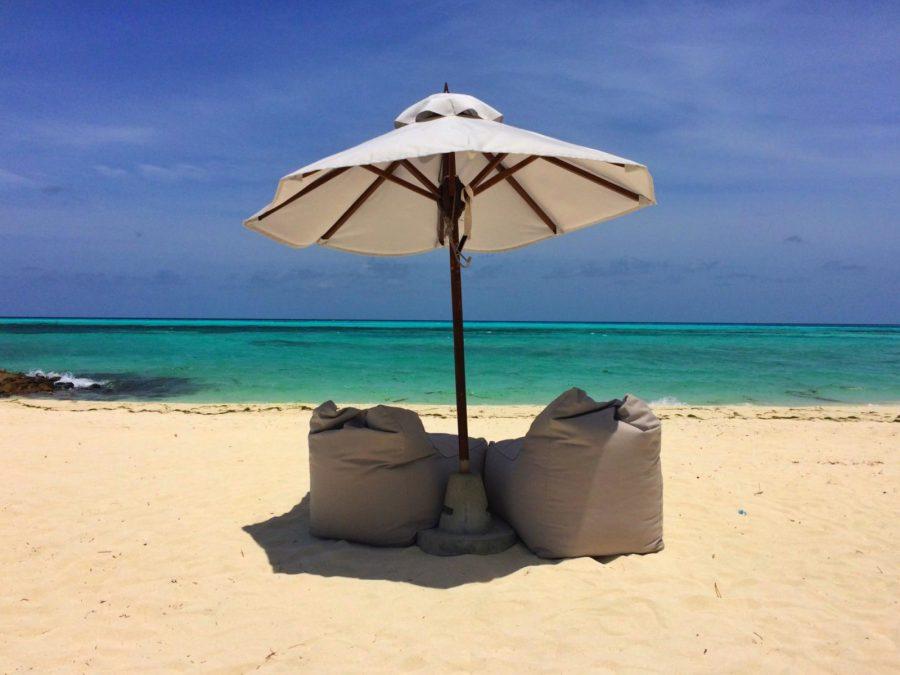 blue skies beach parasol umbrella the maldives