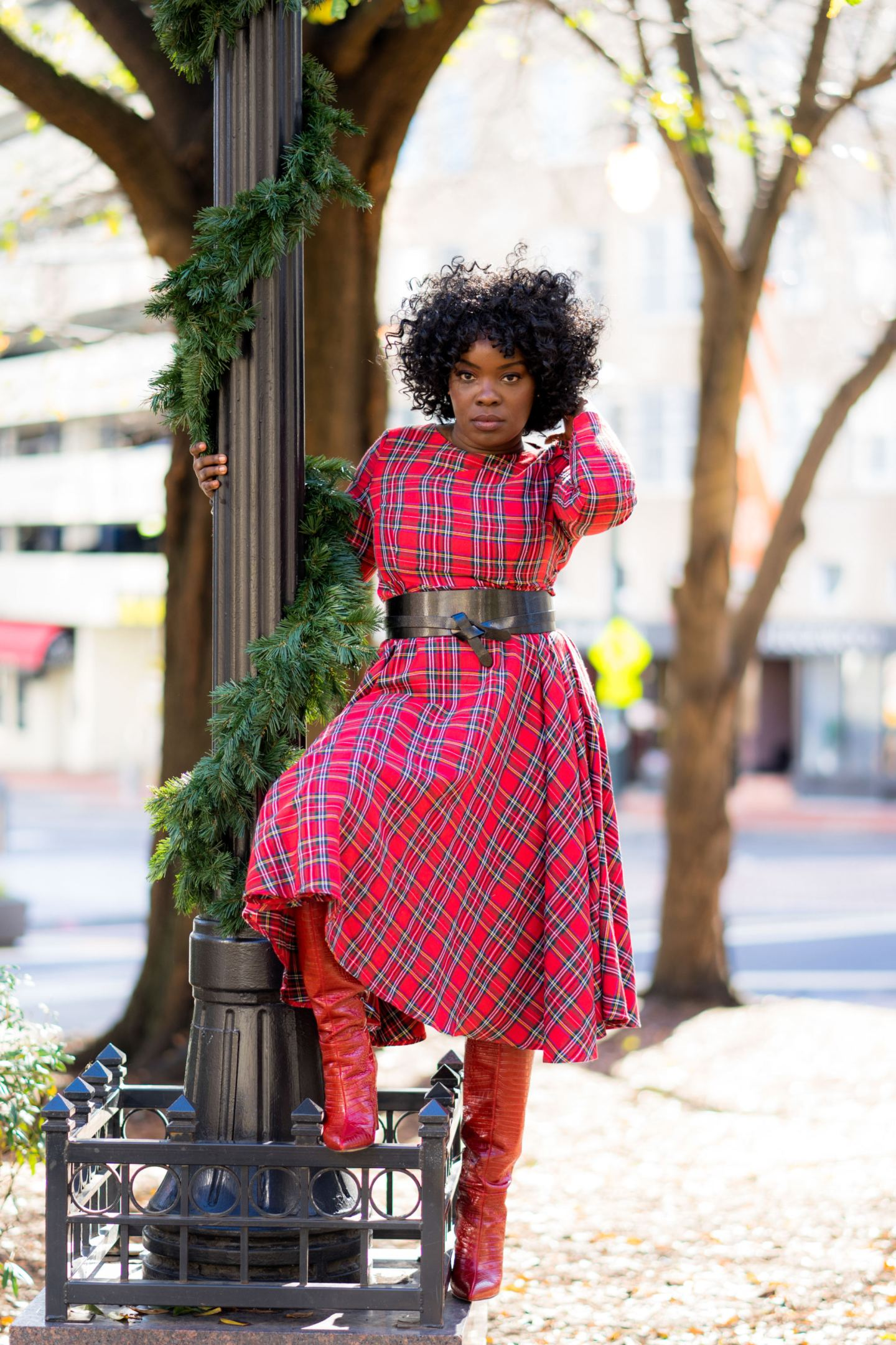 Black woman wearing red thrift store dress