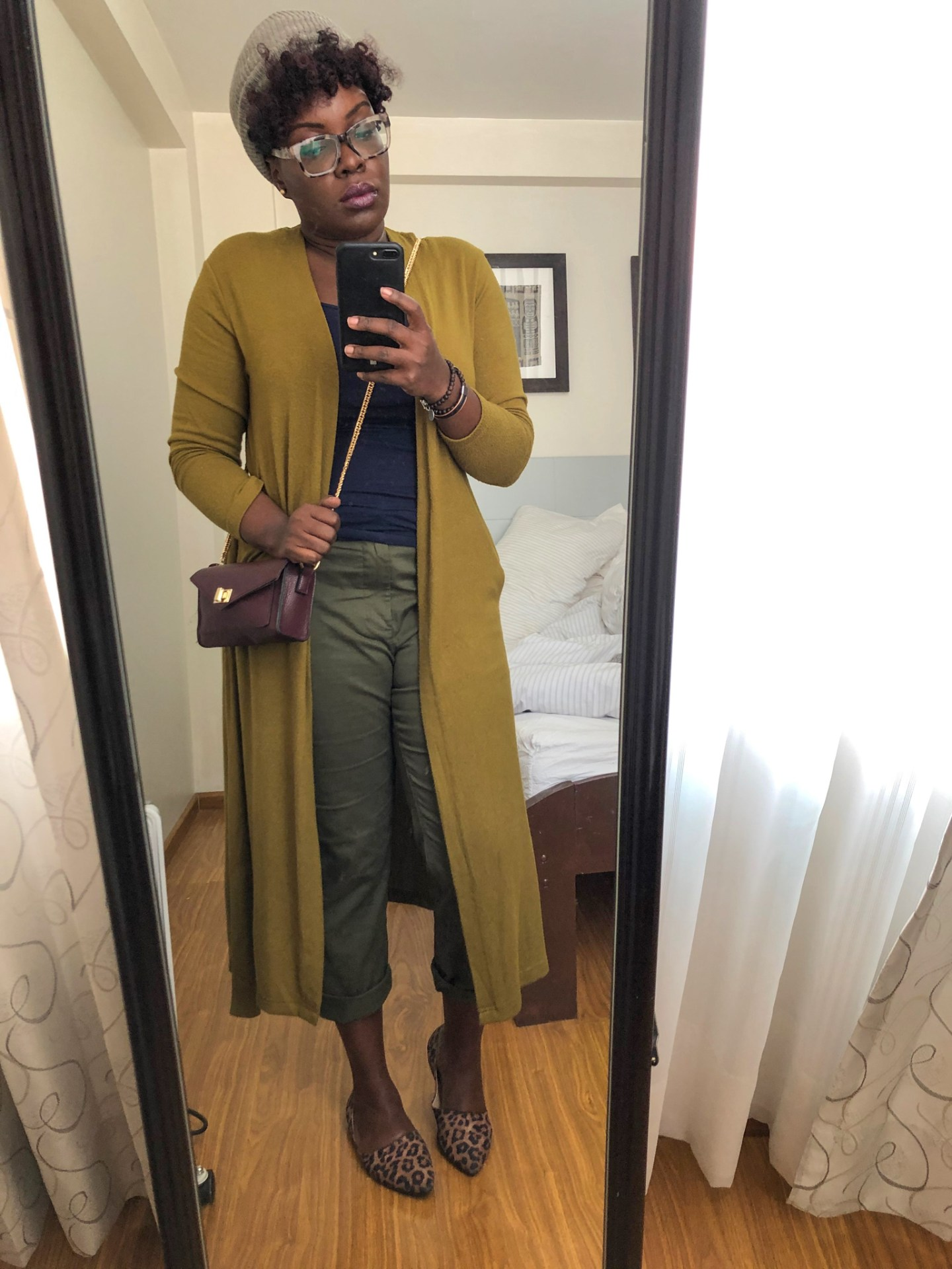 Black travel blogger in Cusco Peru wearing JCrew chinos