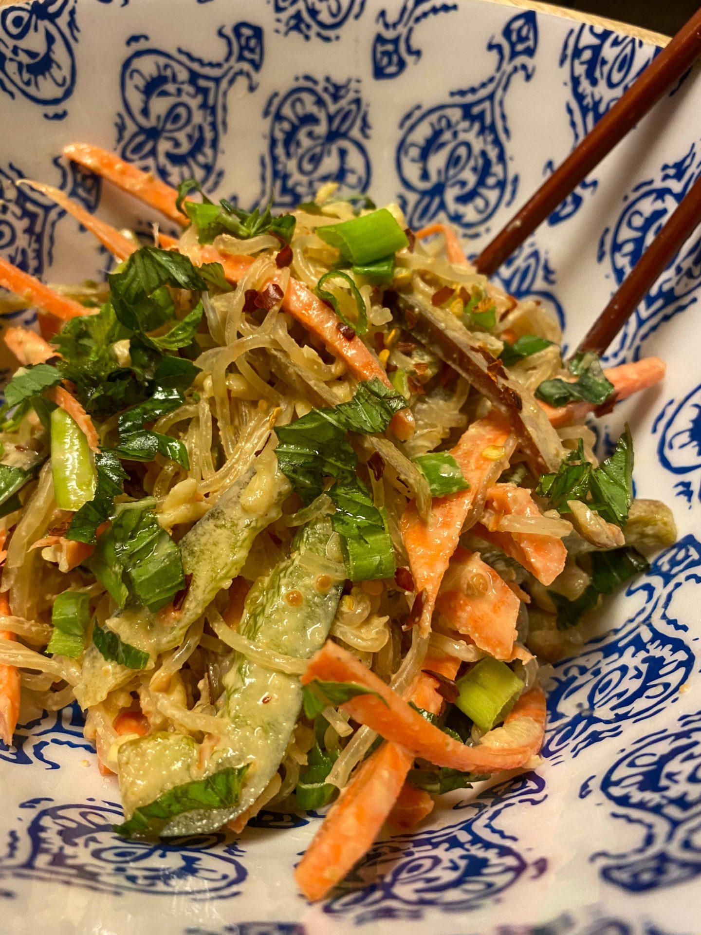 Raw vegan pad thai in a wooden bowl