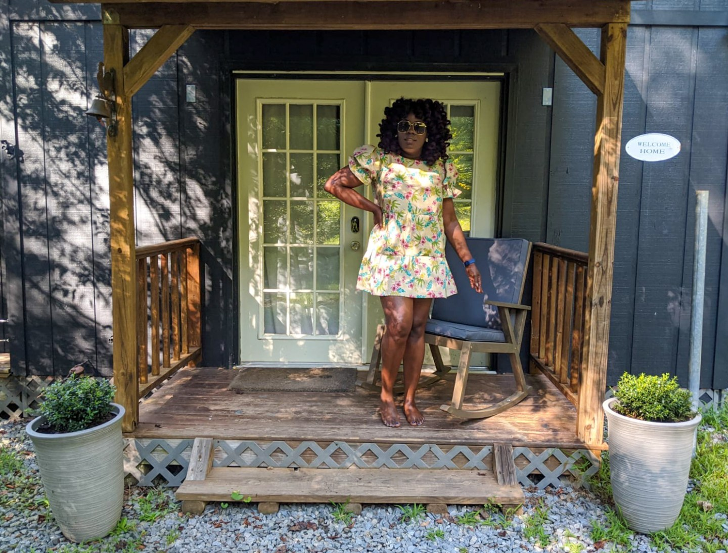 Black girl wearing Simplicity 8839 in front of Barn in the Georgia mountains.