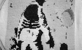 Embroidered image of a soldier and child by Betsy Greer.