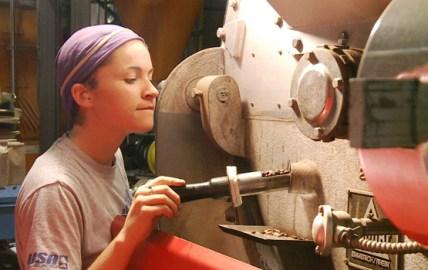 Mallory White of Equal Exchange checks coffee roaster