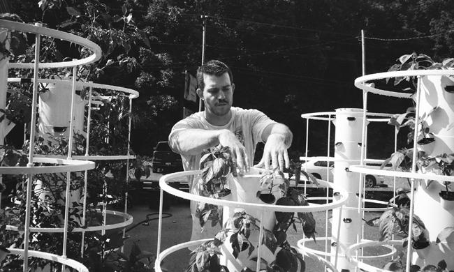 Joel McKinney with hydroponic towers