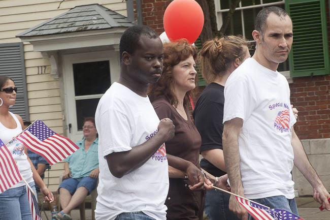 3 marchers with red balloon
