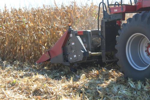 small resolution of stalk devastator running under the corn head to crimp and crush old stalks