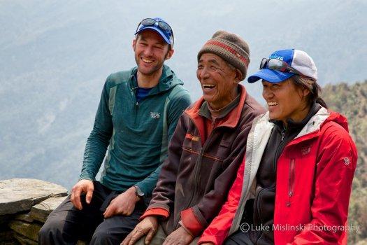 Glen and Karma share a laugh with a Sibuje elder by Luke Mislinski