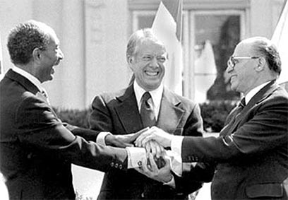 Image result for 1979 – Anwar al-Sadat, Menachem Begin & Jimmy Carter sign the Egypt–Israel Peace Treaty in Washington, D.C