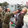 Lt. Col. Eisner beating Danish activist