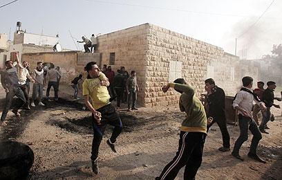 """העימות בטמון, השבוע. """"ההחרפה נבנתה בהדרגה"""" (צילום:  AFP)"""