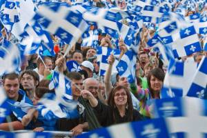 The photo depicts French-Canadians waving the flag of Quebec (most likely during the national St.-Jean-Baptiste Day).