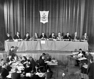 The black-and-while photo depicts the Commission on Bilingualism and Biculturalism, 1963-1971, established under Prime Minister Pearson to examine cultural dualism in Canada.