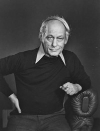The photo depicts René Lévesque-a founder and leader of the openly separatist Parti Québécois, who served as a premier of Quebec from 1976 to 1985- sitting on a chair and positing for a picture.