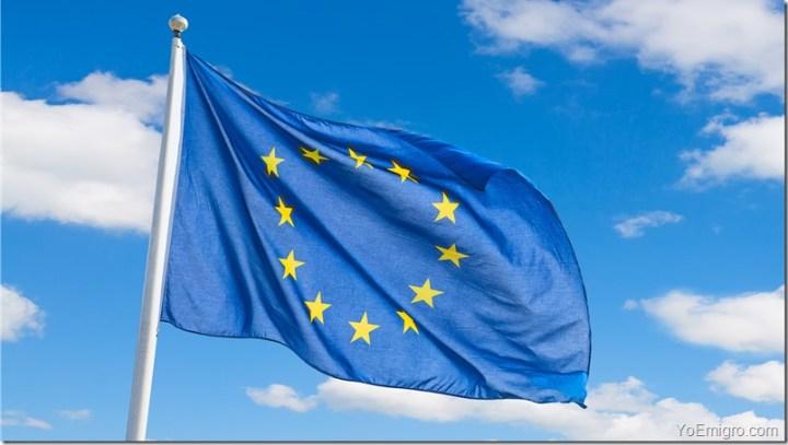 Waving European Union flag against blue sky background.