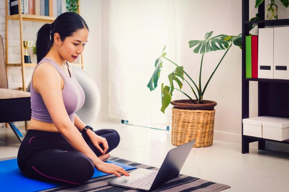 woman practicing morning yoga video