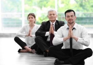 Business people meditating on productivity and business in the office.