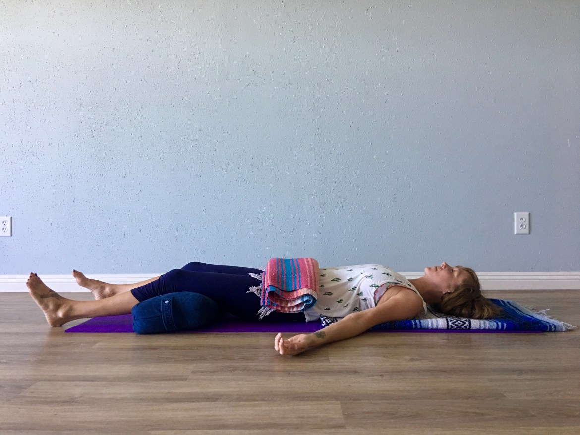 Savasana with weight to belly