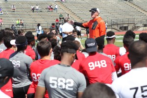 Brian Stumpf talks to high school football players during the Elite 11 and The Opening Regional Camp