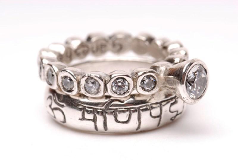 Ganesha Sharanam ring, top, Om Mani Padme Om ring, bottom