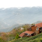 Beautiful red wooden house amidst a sea of mountains and clouds