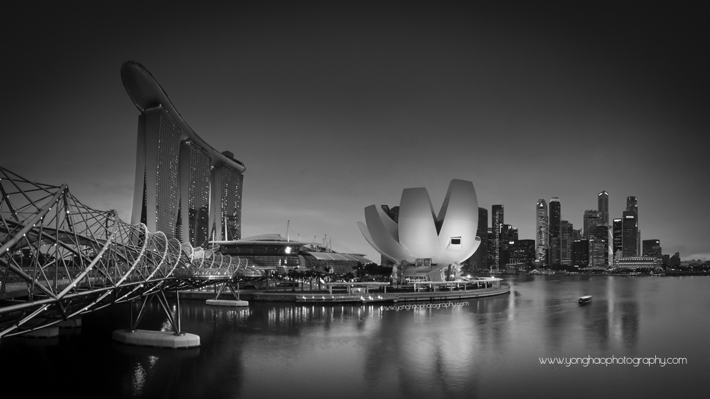 Black white singapore skyline helix bridge leading to mbs art science museum and