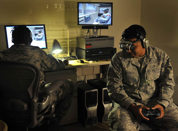 Senior Airman Joseph Vargas, a pharmacy technician with the 779th Medical Support Squadron, uses the Virtual Iraq program at Malcolm Grow Medical Center's Virtually Better training site on Andrews Air Force Base, Md. on June 25, 2009. The 79th Medical Wing is one of eight wings to use this new technology to treat patients suffering from post traumatic stress disorder. (U.S. Air Force photo by Senior Airman Renae Kleckner)(released)