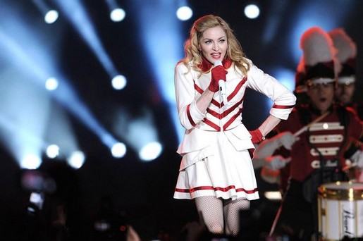 Madonna's regression continues as she dresses as a cheerleader and shows off her bum