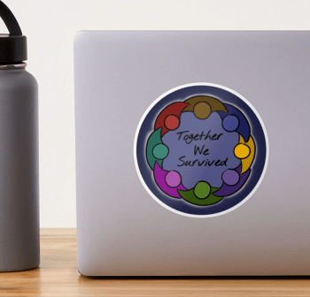 A sticker on a silver laptop: the design is a geometric representation of a circle of people with joined arms, in a rainbow of colors, surrounding a mid-toned blue background and the words Together We Survived, in handwriting the center. The simple figures are outlined by hand-drawn pen strokes, and surrounding their circle is a faint glow of white light and a border of dark blue.