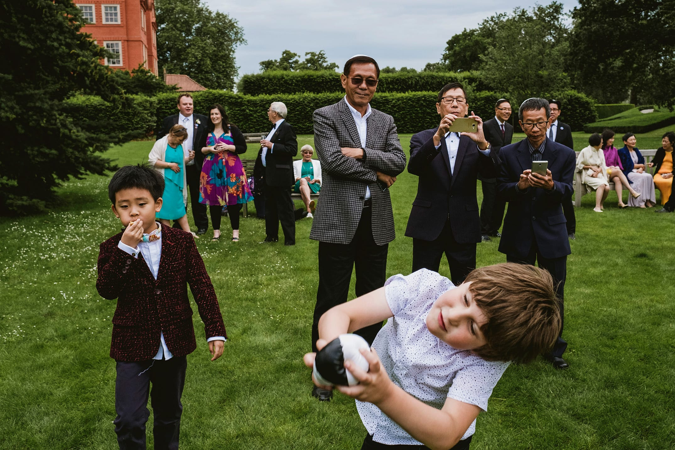 Kew Gardens wedding reception. Guests playing in the garden.