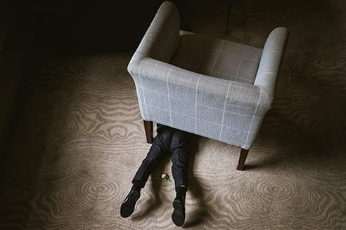 Morden Hall Wedding Photography in London boy hiding under a chair